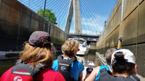 Wellness Warriors 2016 moving boats through the Charles River lock at season start